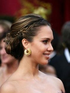 Braids worked into a voluminous chignon add a fresh point of interest.