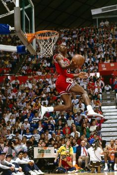 40cfd381c79 Michael Jordan #23 of the Chicago Bulls goes for a dunk during the Slam Dunk