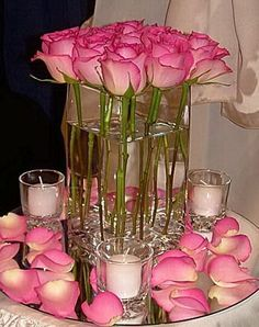 Elegant Pink Long Stem Roses in a Tall Glass Vase, Surrounded By Votive Candles & Rose Petals
