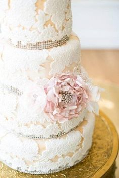 Lace wedding cake with large pink flower