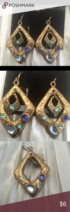 ANTIQUE VINTAGE EARRINGS . Bundle & save! AUTHENTIC ANTIQUE VINTAGE EARRINGS purchased from antique shop in Northern Cali. Just thought they had a cool and unusual look. A combo of materials with design, shape and rhinestones gives these vintage earrings a cool vibe in an antique style. I have not cleaned the vintage jewelry only because I am not positive of the material..going to use silver & gold cleaner will give better idea on the material they are created from. If you have questions…