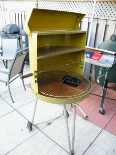 Vintage charcoal grill. Rotisarie chicken. Top flip -up compartment was to keep bread rolls or side dishes warm.