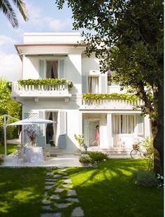 White with pale blue shutters. Love the walkway