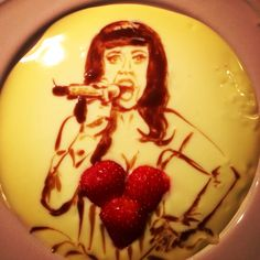 Katy Perry with some strawberries! In the custard/vla of course