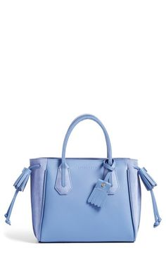 Free shipping and returns on Longchamp 'Small Penelope Fantasie' Leather Tote at Nordstrom.com. A fresh take on Longchamp's Penelope bag, this smooth leather tote in a soft periwinkle hue is detailed with drawstring tassels, piping and sleek rolled top handles. The compact silhouette features a just-right lined interior with pockets and a convenient key clip, as well as an optional logo-stamped charm.