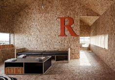 OSB overload. London-based Carl Turner Architects transformed an old barn in Cambridgeshire into an inspiring guest house, studio and meeting place.