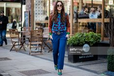 Tamara Kalinic wearing blue pants, Gucci, green heels, Gucci sweater, green Prada bag seen outside J.W. Anderson during London Fashion Week February 2018 on February 17, 2018 in London, England.