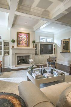 art over fireplace - beamed ceilings - art lover's dream home