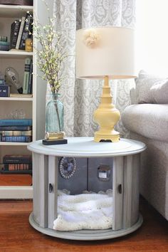 DIY doggie bed out of a side table, check out the painted gray side table and painted yellow lamp love the gray window shade too