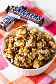 Decadent, delicious, sweet and salty, Snickers Popcorn from @CakeNKnife cakenknife.com