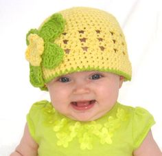 Crochet baby hat with tropical flower