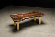 Fremont Coffee Table by AntonMakaDesigns Live Edge Black Walnut Slab Top w/ Metal Base shown in Brass Powder coat Inquire for custom size and finish