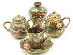 CLOISONNE TEA ITEMS & A VASE Japanese cloisonne cup, saucer and sugar pot of the same pattern late 1800s