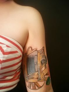 My unhealed, unfinished ink by the incomparable Nate Beavers  large format camera tattoo, future half sleeve