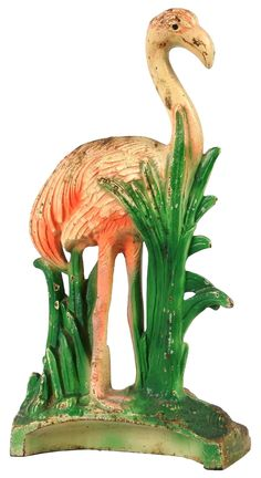Full-figure, solid casting. Depicts a flamingo walking in marsh grass.