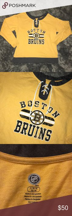 BOSTON BRUINS NHL Sweatshirt Size women's Large. Lightweight sweatshirt. Distressed old school logo on chest. Yellow/gold in color with charcoal gray trim on neck and waist. Cute rope lace-up at chest/neckline. Worn once to a game. Received lots of compliments. Smoke-free home. Excellent condition. Perfect for any Boston fan or hockey fan. NHL Official Licensed Product Tops Sweatshirts & Hoodies