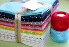 19 Fat Quarters, each measuring approx. 18 x 22. Factory cut.    Fantastic colors, you get the solid with a white swiss dot & then white with the