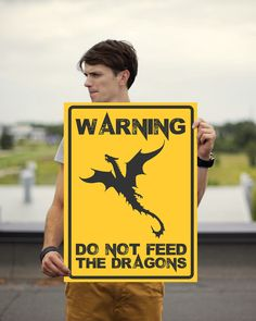 "Fan of Dungeons & Dragons? We have a very nice Warning sign. ""Warning! Do Not Feed The Dragons"" The size is 18x24"" Museum-quality posters made on thick, durable, matte paper. A statement in any room."