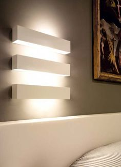 Net Muro indoor wall lamp IP20 for direct or indirect lighting. made of polished stainless steel, white or grey painted metal or weathered brass, it is available in two versions: net 24 (l. 240mm) and net 48 (l. 480mm). it can take halogen and fluorescent lamps. extremely versatile, it can be used to light both private and public spaces.