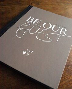front of our guest book...  'Be Our Guest' Guestbook // Subtle Disney Wedding Ideas // Featured: The Knot Blog