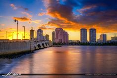 Explosive sunset from West Palm Beach Florida over the skyline in Palm Beach County along the waterway. HDR image created using Photoshop and Aurora HDR software.