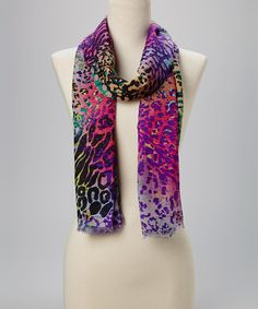 Being+fashionable+is+as+easy+as+wrapping+around+this+smooth+scarf.+The+mix+of+patterns+and+colors+create+a+refreshing+look+that's+sure+to+enliven+any+ensemble.