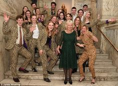 Camilla enjoyed herself posing with a group of people dressed in tiger suits inside the Victoria and Albert Museum