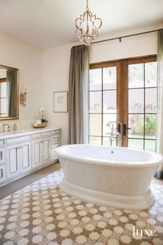 Facings of America tile floor from Modern Group Center Stage Tub in Scottsdale Master Bathroom with Chandelier