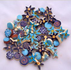 A mix of handmade blue tile dots and petite flowers in a variety of shades and detailing.