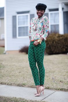 The always radiant Nifesimi in a floral blouse and green bow print trousers with pink Louboutin pumps (from Skinny Hipster)