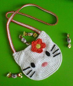 hello kitty crochet purse - free diagram pattern!  so adorable!!! and like OMG! get some yourself some pawtastic adorable cat shirts, cat socks, and other cat apparel by tapping the pin!