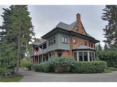 This stately home in Mount Royal has everything a royal could possibly want: flags at the entranceway, a tennis court and, of course, 6.5 bathrooms. #yyc #neighbourhoods #house #mountroyal #mansions