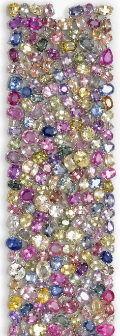 Colorful sapphire and diamond bracelet, composed of various-shaped multi-color sapphires with interspersed rose-cut diamonds; estimated total colored sapphire weight: 182.00 carats; estimated total diamond weight: 2.00 carats; mounted in eighteen karat white gold; length: 7in.; width: 1 3/4in. Via Diamonds in the Library.