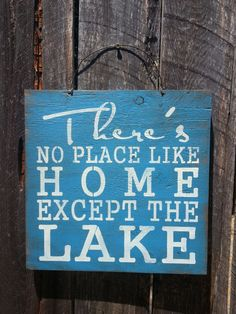 Theres No Place Like Home Except The Lake sign is hand painted to look rustic. Made on 12x 12 outdoor plywood with a wire hanger on top for
