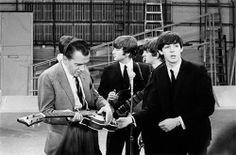 Paul doesn't quite want to let go. It's The Beatles with Ed Sullivan.