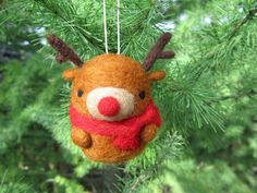 ~Made to Order~ Add a little woodland wonder to your Christmas tree with this cute needle felted reindeer ornament. He comes wearing a cozy red scarf and Rudolphs signature red nose and is handmade with love out of 100% natural wool. This little reindeer friend would make a perfect Christmas gift for anyone in your life or can be used as a decorative item to add some Christmas cheer to your home. It would look perfect hanging on your tree or sitting on a table top. You can order this…