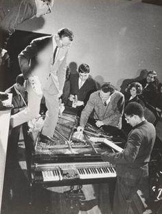 Philip Corner with Emmett Williams, George Maciunas, Benjamin Patterson, Dick Higgins, and Alison Knowles. Piano Activities, performed during Fluxus Internationale Festpiele Neuester Musik, Hörsaal des Städtischen Museums, Wiesbaden, Germany, September 1, 1962.