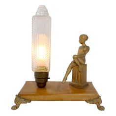 ART DECO TABLE LAMP WITH GLASS AND CAST IRON FIGURE - $245.