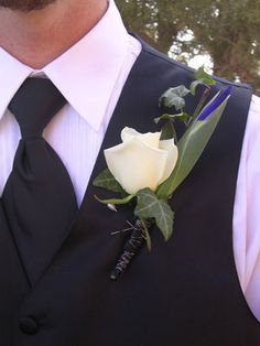 white rose with iris bud boutonniere