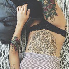 Mandala stomach tattoo