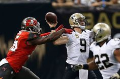Drew Brees looks at Terron Armstead of the New Orleans Saints during a game against the Tampa Bay Buccaneers at Mercedes-Benz Superdome on September 2015 in New Orleans Louisiana. The Buccaneers. Get premium, high resolution news photos at Getty Images Nfl Football Players, Football Helmets, Nfl Weekly Schedule, Luke Kuechly, New Orleans Saints Football, Rotator Cuff, New Orleans Louisiana, Nfl Season, Long Shot
