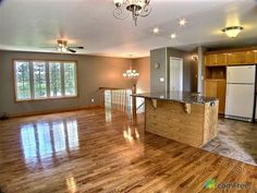 Split level ranch remodel - Google Search odd island placement - better if it were turned the other way to create more space in the kitchen, and would also look larger to run the same wood flooring into the kitchen. Hardwood would be more modern with a less glossy satin finish