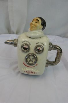 "shopgoodwill.com: Teapot - Man in a Steam Bath - Made in England A very cute ceramic teapot made by Swineside Teapottery.  It is also stamped ""Made in England"".  It is a man enjoying a steam bath, with only his head visible.  It is in good condition, with no chips or cracks found.  It is 7 1/4"" x 7"" with the lid (head) on."