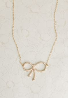 String Of Pearls Bow Necklace
