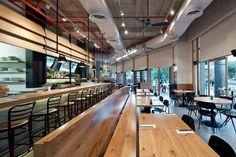 I love the industrial look Levy:Chamizer Architects studio realized for Giraffe Restaurant from Tel Aviv, Israel. Douglas Fir, Tel Aviv, Interior Design Studio, Giraffe, Concrete, Industrial, Restaurant, Architecture, Wood