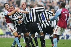 Aston Villa's Gareth Barry tries to help separate brawling Newcastle players Lee Bowyer and Kieron Dyer