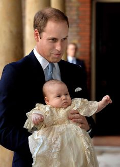 Prince William, Duke of Cambridge with his son Prince George at Chapel Royal in St James's Palace, 23.10.13
