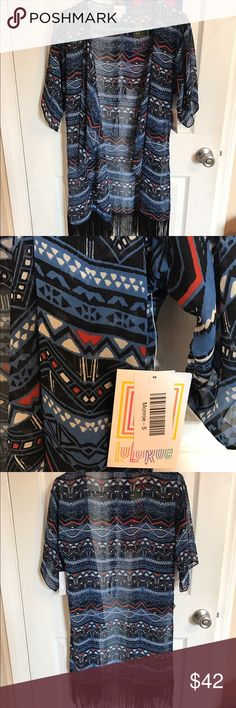 Monroe Brand new. Black, blue, white and hints of red. Black fringe along the bottom. Has small pulling on the tag area, see pic 1 for details. LuLaRoe Tops