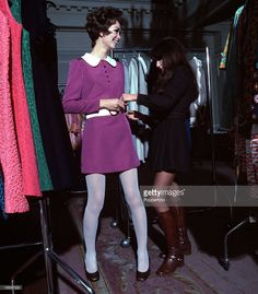 England, 1968, A girl is pictured being fitted for a mini dress at a clothes shop