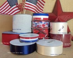 Americana style ribbons and craft embellishments from Cottage Crafts Online. Flag designs, stars and stripes, solid, plaid and patterned red, white and blue ribbons. Liberty bells.